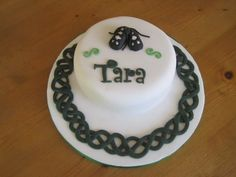 Celebration Cake for my cousin who has just passed her Irish Dancing teaching exams. The cake has a little pair of soft shoes on top with cu...