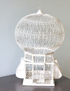 Pretty fantastic. Vintage Whimsical White Birdcage from bellalulu on Etsy $98.00