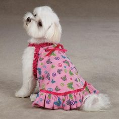 Our East Side Collection Butterfly Garden Dog Dress is a lightweight, fun and flirty dress. The comfortable pullover, easy fit sleeveless design features an all-over butterfly, peace sign, and heart pattern. Pink ruffle trim at the neck and shoulders and pink ribbon accents add interesting details.