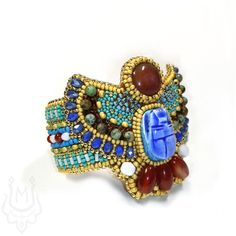 Buy Egyptian style bracelet with scarab and carnelian. Handmade beaded jewelry in ancient egyptian theme. Bead Embroidered Bracelet, Beaded Embroidery, Beaded Bracelets, Bangles, Handmade Beaded Jewelry, Handmade Necklaces, Art Deco Jewelry, Modern Jewelry, Ancient Egyptian Jewelry