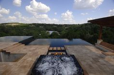 Infinity pools have one or multiple edges overflowing into a secondary pool or basin. This gives the illusion that the water extends to the horizon, making infinity pools the perfect compliment to … Modern Exterior, Exterior Design, Swimming Pool Designs, Swimming Pools, Home Design, Design Ideas, Modern Design, Design Inspiration, Outdoor Fire