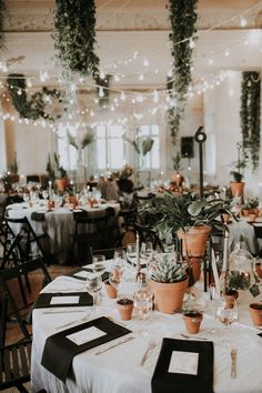Plant heaven at this whimsical and neutral wedding reception | Image by Linda Lauva Photography