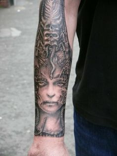 giger woman with skulls and snake by Kevin Paul Seventh Day Tattoo