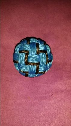 A 50 facet globe knot around a 40mm ping-pong ball. Four passes in 325 paracord. Thanks to Don Burrhus for his globe knot cookbook.