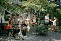 Friends eat watermelon outside a beach cottage on a summer afternoon on Roanoke Island, North Carolina, 1955.