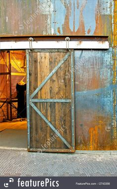 Architectural Details: Grunge sliding door at old rusty warehouse