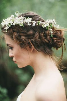 A beautiful braid up do matched beautifully with a white crown.