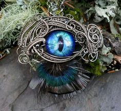 Gothic Steampunk Cat Evil Eye Necklace with Feathers. $79.95, via Etsy.
