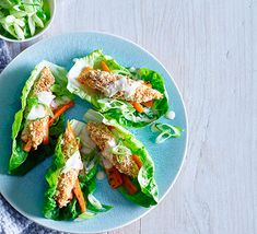 An easy everyday supper that's low in calories and 2 of our 5-a-day? Sign us up! These crisp lettuce cups, seasoned goujons and tahini drizzle make a tasty meal that won't break the bank either