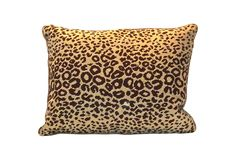 Vintage needlepoint leopard pillow with zippered tan cotton back.
