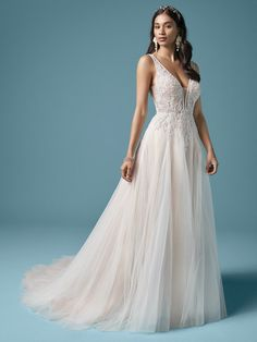 Rudy| V-back A-Line wedding dress in dreamy boho beading and layered tulle skirt. #wedding #weddingdress #weddingdresses #bridal #bride #bridalgown #weddingplanning #weddingfashion #maggiesottero