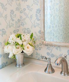 Wallpaper- mirror- floral arrangement. Simple but effective little touches.