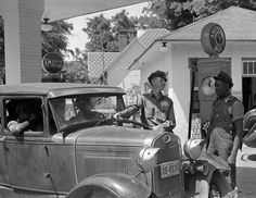 Photo shows view of gas station attendants filling up an old car with gas at an Amoco gas station in Atlanta, Georgia. This old, vintage photo dates to Vintage Photographs, Vintage Photos, Cities, Old Gas Stations, Boston Public Library, Book Sites, Green Books, Romantic Photos, Gas Pumps