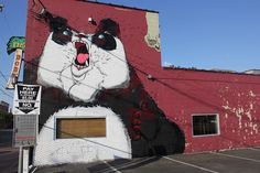 I love this angry panda and how the sign on the side of the building looks like a hammer he's waving in his right hand.