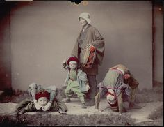 Drummer with three child acrobats in costume, ca. 1860s by Kusakabe Kimbei
