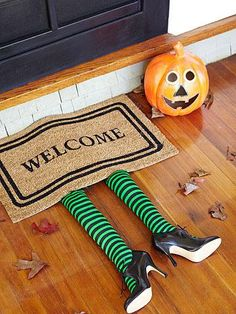 <p>Cut the legs from a pair of striped stockings ($10; welovecolors.com) and stuff them with cotton batting, then glue them underneath a welcome mat and add witchlike shoes.</p>