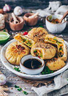 "This is a simple step-by-step recipe for pan-fried steamed Bao buns ""sheng Jian bao"" - The vegan version of pork soup dumplings stuffed with leek & veggies!"