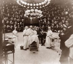 This is a photograph from 1902 showing a patient about to get an operation. The interesting thing is the large crowd of spectators. One would assume that they are medical students, or somehow there for a reason. It creates an unusual image, since they are there in street clothes . . . they look like they are attending the opera. The picture was taken at the Jefferson Medical College Hospital.
