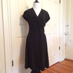 Banana republic LBD Worn once this LBD is a classic must have! Adorable twist top with a flattering Drape this will look good on all figures! Banana Republic Dresses