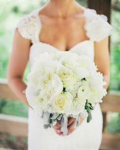 The bride carried a bouquet of white garden roses, peonies, hydrangea, ranunculus, and dusty miller. |  Photo by Rachael Osborn Photography