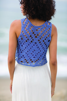Try out filet crochet with this cute Spiral Seashell Top featuring spiral patterning reminiscent of a seashell. Find this pattern by Nicoletta Tronci in Interweave Crochet Summer 2017.
