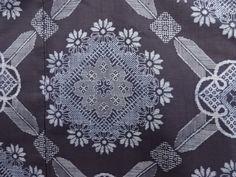 大正ロマン 華紋に矢羽根模様織り出し本場正藍泥染大島紬着物(割り込み絣)