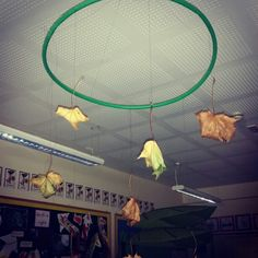 Bringing autumn inside with hanging the leaves from a hoop.