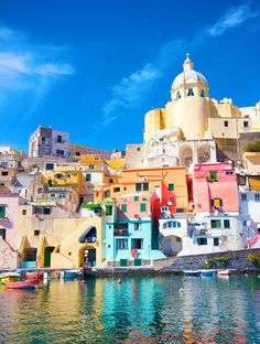 The 15 Most Colorful Places in the World Procida Island, Italy Procida is the quintessential Mediterranean paradise, an absolute vision of colorful harborside homes and picturesque piazzas. The coast is filled with the cutest pastel-colored houses. Places Around The World, The Places Youll Go, Places To See, Beautiful Places In The World, Amazing Places, Dream Vacations, Vacation Spots, Vacation Ideas, Vacation