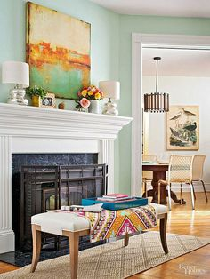 A big bold painting brings serious flair, and can instantly change the vibe of any space. Whether hung above a fireplace, sofa, or elsewhere in the room, a painting can create a focal point with impact and add both color and dimension. Pick up a few of its colors in accessories, like pillows, to highlight the piece even more./
