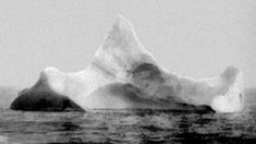 The iceberg that is thought to have sunk the Titanic. Black and red paint is smeared along the side.