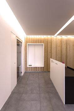 Law Firm Office in Milan by +R / www.piuerre.com / photo by Alberto Canepa / www.albertocanepa.com /  #wood #custom #furniture #cupboard #zigzag #boiserie #interior #polycharbonate #office #translucent #materials #lighting #reception