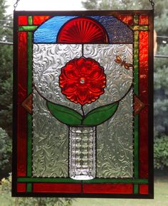 This breathtaking stained glass panel will look stunning hanging in your window. This is a one of a kind panel I designed to add beauty to