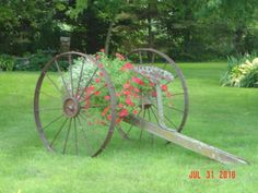 Old kitchen sink mounted on iron wheels with old tractor seat.
