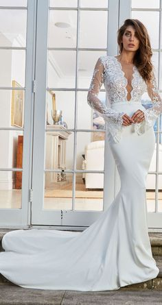 Bodysuit with plunging neckline and bel long lace sleeves mermaid wedding dress #wedding #weddingdress #bridedress leah da gloria