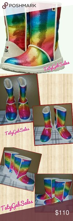 I Heart UGG Australia Sparkles Rainbow Boots MAKE YOUR OFFER!!!  * UGG  Sparkles Rainbow Boots * NEW WITHOUT BOX  * US 7. UK 5.5 EU 38. Japan 24  * Soft suede upper with contrast stitching.  * Heart skull on upper shaft.  * Fully UGG pure sheepskin lined.  * Hidden stash pocket inside shaft. * May have some dust at white parts for been outside the box at store * Have a little spot in the top of left boot  * 100% Authentic UGGs. NOTE that this is a display pair and may show signs of being…