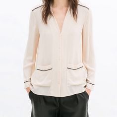 Zara pajama-style blouse New with tags. Nude. Pajama style blouse with contrasting trim. Long sleeves, vneck, and pockets on bottom front. 🚫no trades or paypal 🚫 Zara Tops Blouses