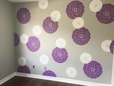 A DIY stenciled nursery accent wall in purple, gray, and white using the Summer Blossoms Flower Stencils from Cutting Edge Stencils.   http://www.cuttingedgestencils.com/flower-stencils-summer-blossom-floral-wall-stencil-design.html?utm_source=JCG&utm_medium=Pinterest&utm_campaign=Summer%20Blossom%20Wall%20Art%20Stencil