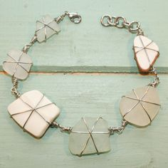 Beach Shack Project -surgical stainless steel wire wrapped sea glass and pottery bracelet. £16