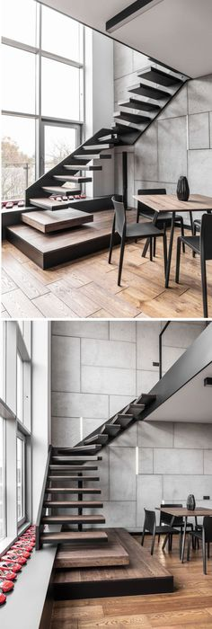 This staircase that leads up to the mezzanine level is made from black steel and wood stair treads.