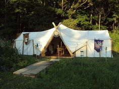 How to make a Viking style large tent using two wall tents. In the dogtrot middle, the Viking frame and canvas cover. Simply Brilliant!