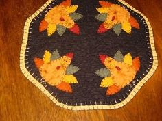 Offered to you by: Bits of Cloth Get ready for some Fall designs This is a new primitive candle mat. I have handcrafted this from woolfelt and hand-sewn all the pieces with great care. The candle mat