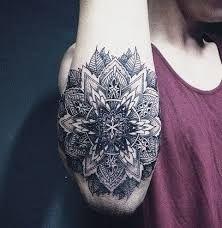 Resultado de imagem para mandala tattoo guys