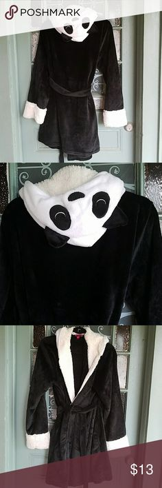 Panda bear robe Brand new super soft cozy panda bear robe size is a large/ extra large. The brand is hot kiss black and white and the hood is a panda head with a cute panda face and ears this is super soft and warm. Hot Kiss Intimates & Sleepwear Robes