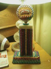Box Tops For Education travelling trophy :)  ----average trophy covered with mardi gras beads and homemade topper