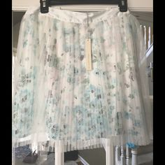 "SaleLC Lauren Conrad Pleated Tulle Skirt Pretty LC floral layered pleated skirt. Size large. Brand new with tags. Mint green Satin waist with elastic waist band in back. 100% Polyester. Machine wash. Waist approx 16"" length approx 18"". LC Lauren Conrad Skirts A-Line or Full"