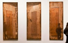 """Walead Beshty """"Copper Surrogate""""  The three panels start out as mirror-finished metal and then, as they get moved and hung in various art spaces, they tarnish wherever a hand has touched them."""