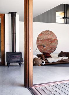 Love the painted yet exposed brick! Wood stove and sunken living room in an Australian vacation home Decor, Simple Decor, House Design, Brick Interior, Interior, Interior Architecture, Room, Beach House Design, Sunken Living Room