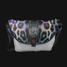 This Rickshaw Messenger bag has multicolored leopard with a band of black, Celtic symbols and an OM. Matching Macbook sleeve to tuck inside available.    The Rickshaw Zero Messenger Bag is a workday commuter, overnight attaché, or travel bag! Vibrantly printed with your custom artwork or text.