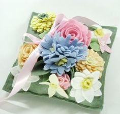 Robins Egg Blue Hyacinth, Pink Roses, Mums, Daffodils, Buttercup Yellow, Blush on Loden Green