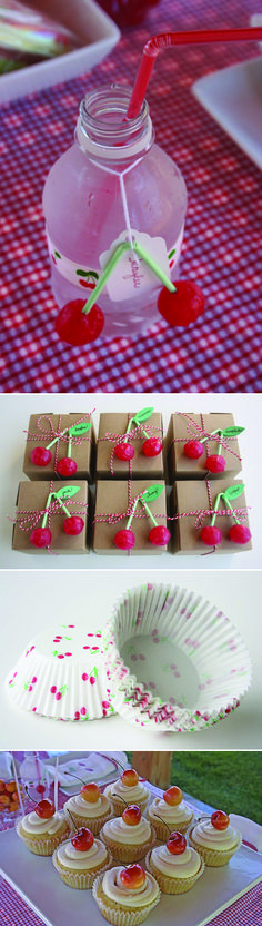 Super-cute cherry decorations, can't tell what they're made of - tootsie roll pops, or marachino cherries & green straws.